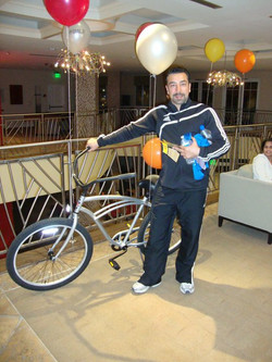 Reza wins the bike
