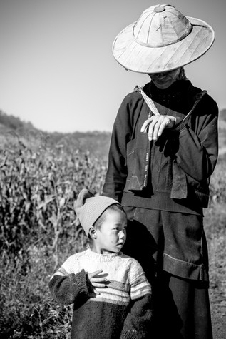 A burmese grandmother and her son in a rural village