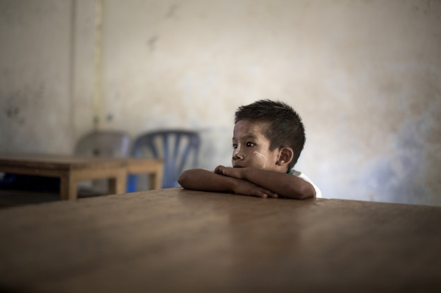 A burmese orphan pays attention to his teacher