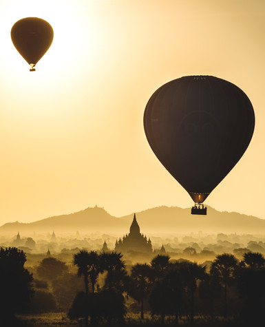Hot air balloons flaoting over Old Bagan on a misty morning