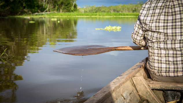 A portfolio image of an indigenous man canoeing by Toronto based commercial photographer BEN HEMMINGS MEDIA