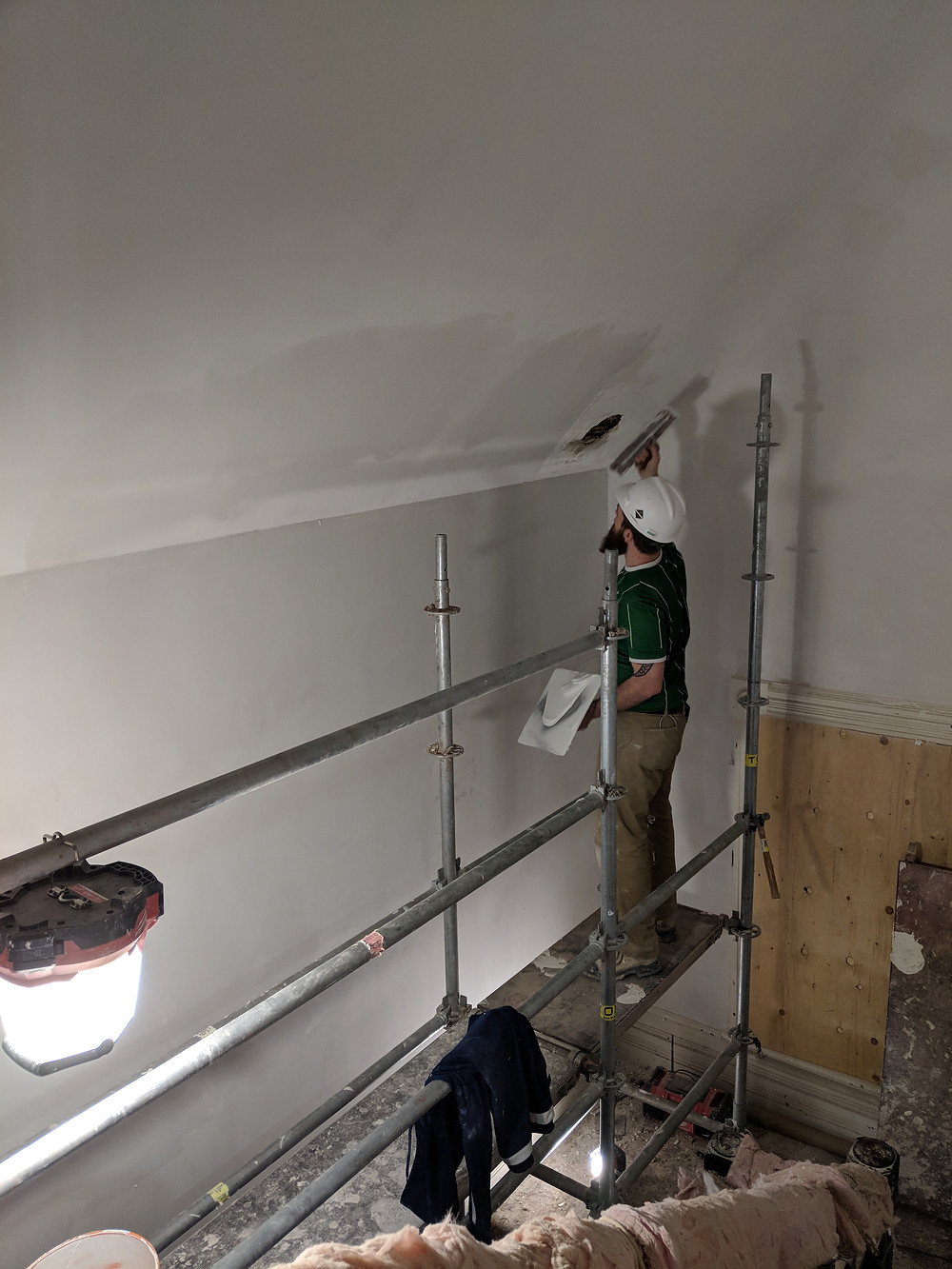 K.Reid Renovations applying plaster to a wall at a restoration project in downtown Toronto