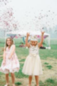 flower girls throwing flower petals