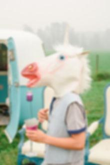 photobooth with boy with unicorn head