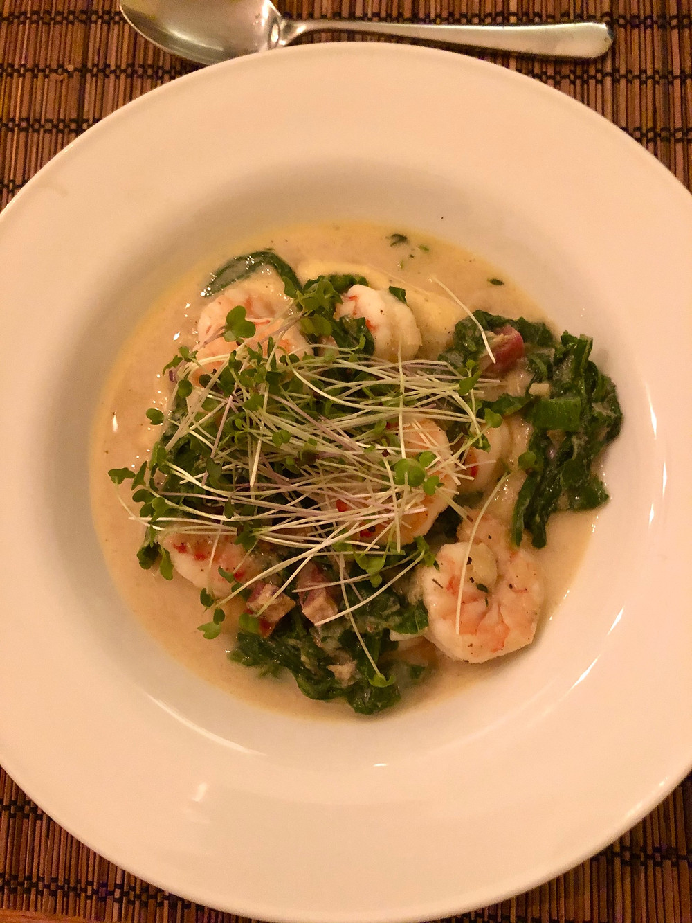 South Carolina Shrimp cooked with turnip green and spring onions over Anson Mills yellow grits