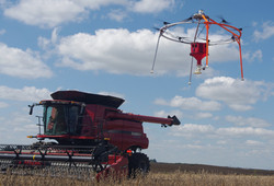 Cover Crop Drone Flying Next to Combine