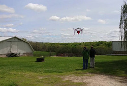 Agriculture drone the Aeroseeeder drone MK 1 mid flight in mission over farm