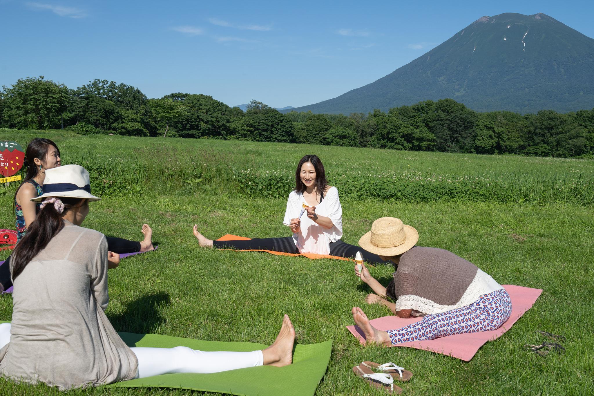 Girls enjoying outdoor yoga in Nisek