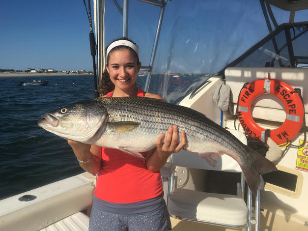 Leanna with a trophy Striped Bass