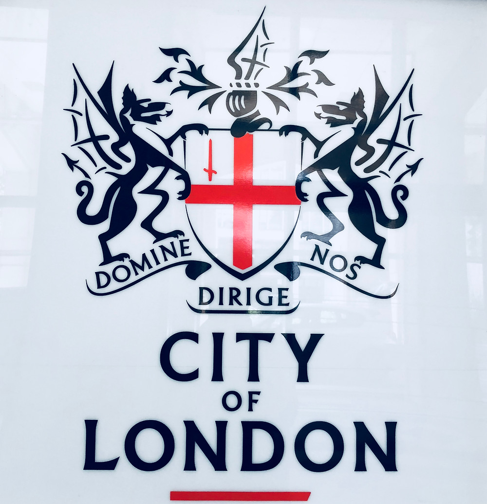 """Coat of arms of the City of London with the Latin phrase, """"Lord, direct (guide) us."""""""