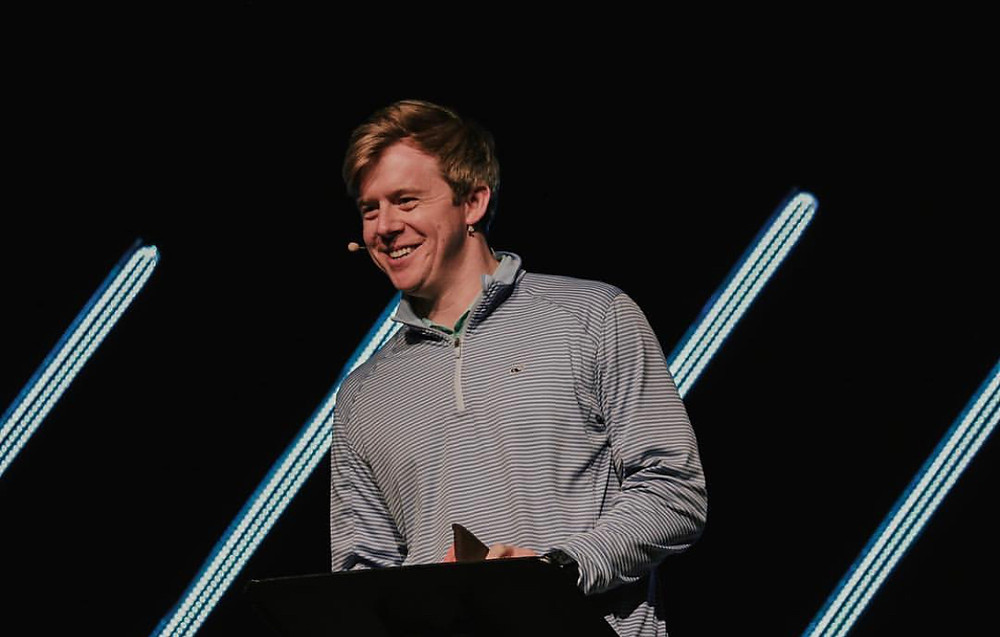 Thomas speaking at City Church U; photo from City Church.