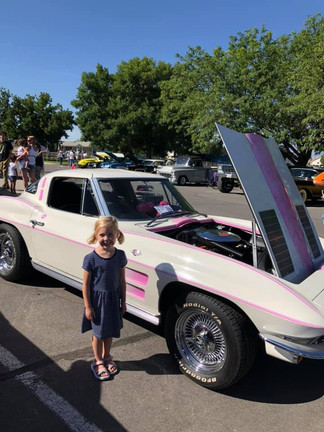 Cute girl by pink & white corvette.jpg