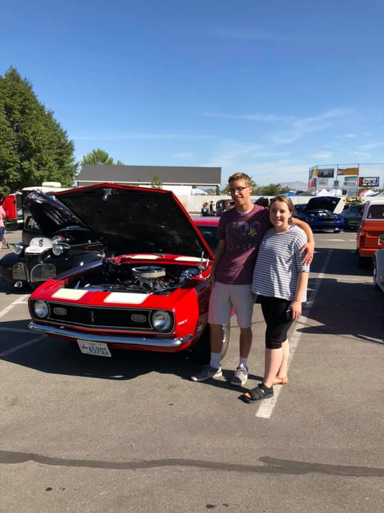 Couple by hot rod.jpg