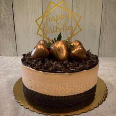 Custom chocolate cheesecake with a fudge brownie bottom