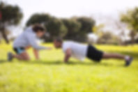 Couple exercising at the city park.jpg
