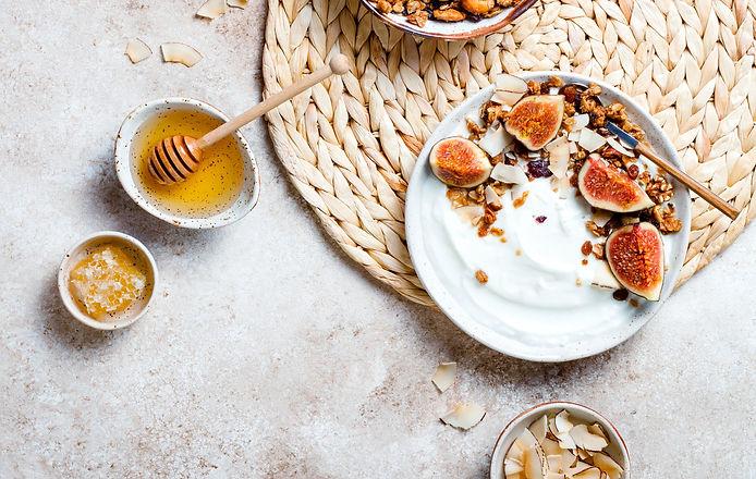 Breakfast-bowls-with-granola%252C-figs%252C-yogurt%252C-coconut-chips-and-honey_edited_edited.jpg