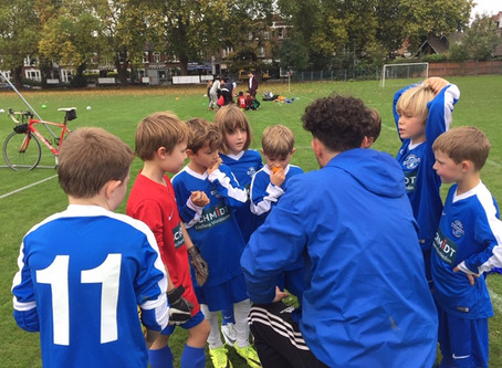 PW DONS Under 9's having a team pep talk with their coach!