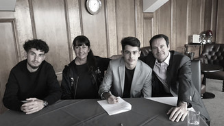 Ryan signs scholarship form for Fulham a