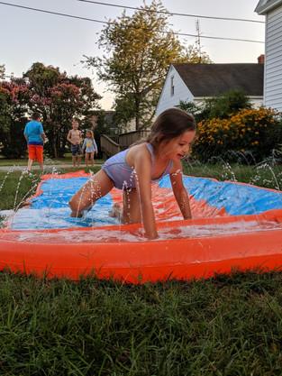 Kids enjoying the slipping slide at the Family Fun Night.