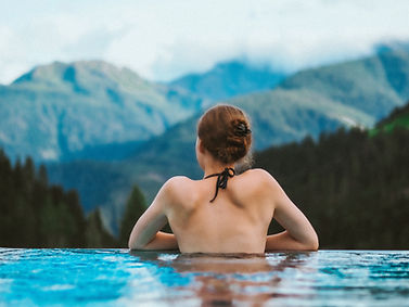 girl in cliff side pool mountain view.jpg