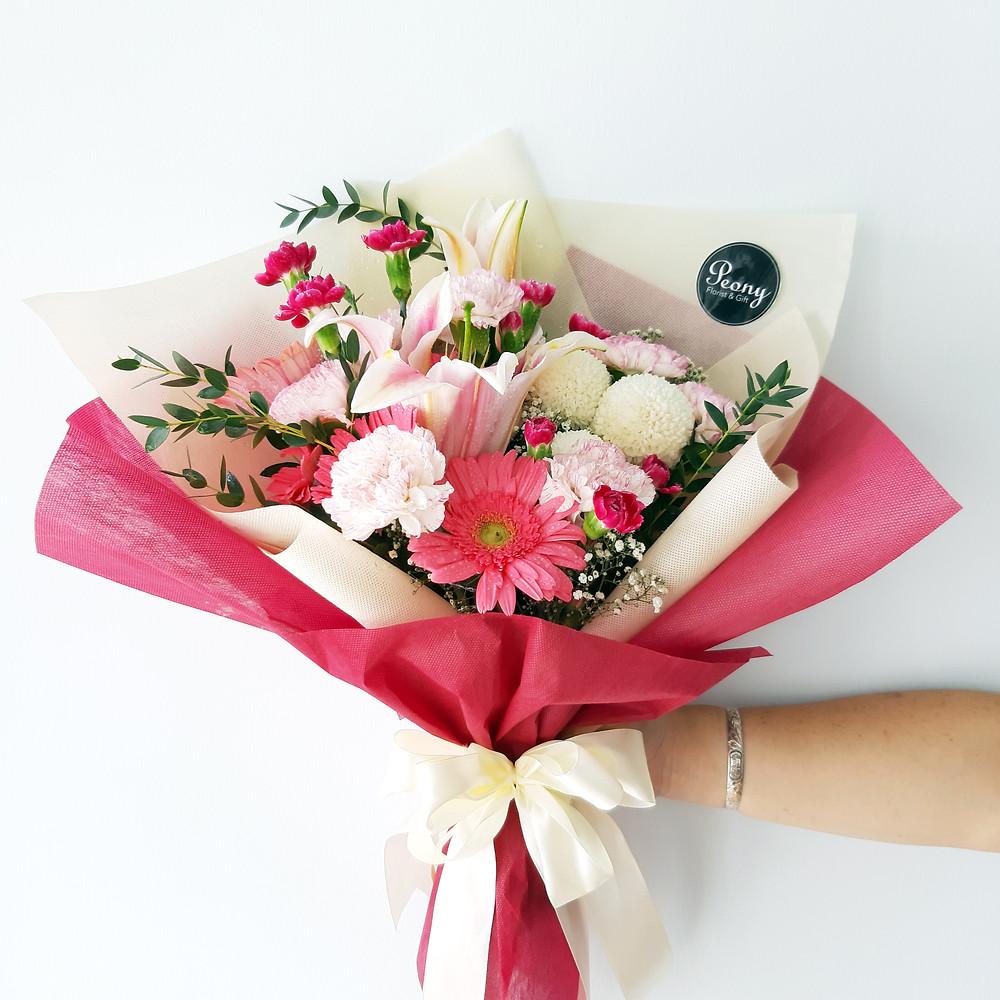 Stargazer Lilies, Carnations, Gerberas and Ping Pong Chrysanthemums.