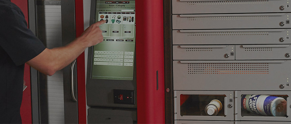 A worker typing in a product on the screen of a FX locker solution.