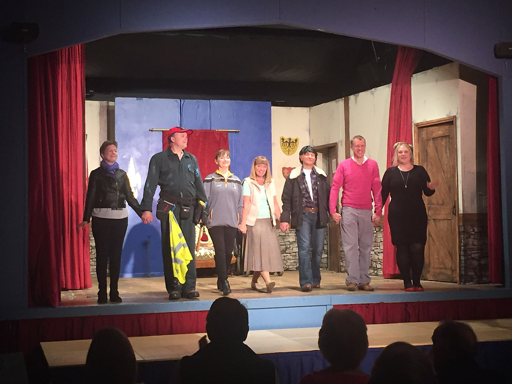 The cast from A Bunch of Amateurs takes their curtain call at the end of their performance.