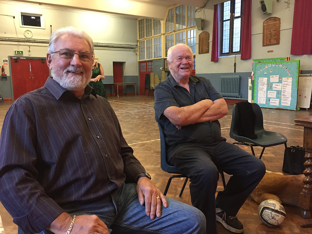 John and Jack sit in the hall at Downsview Methodist Church, Upper Norwood.