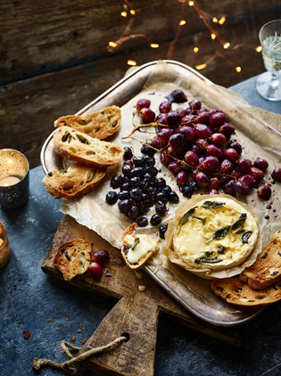 Baked Tunworth and roasted grapes