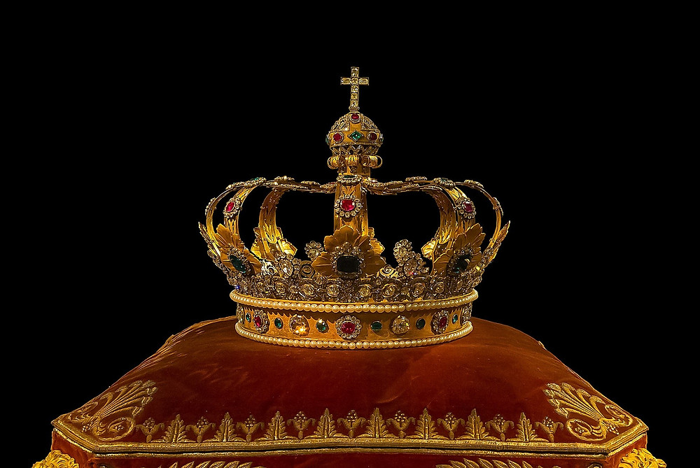 photograph of a crown on a pillow