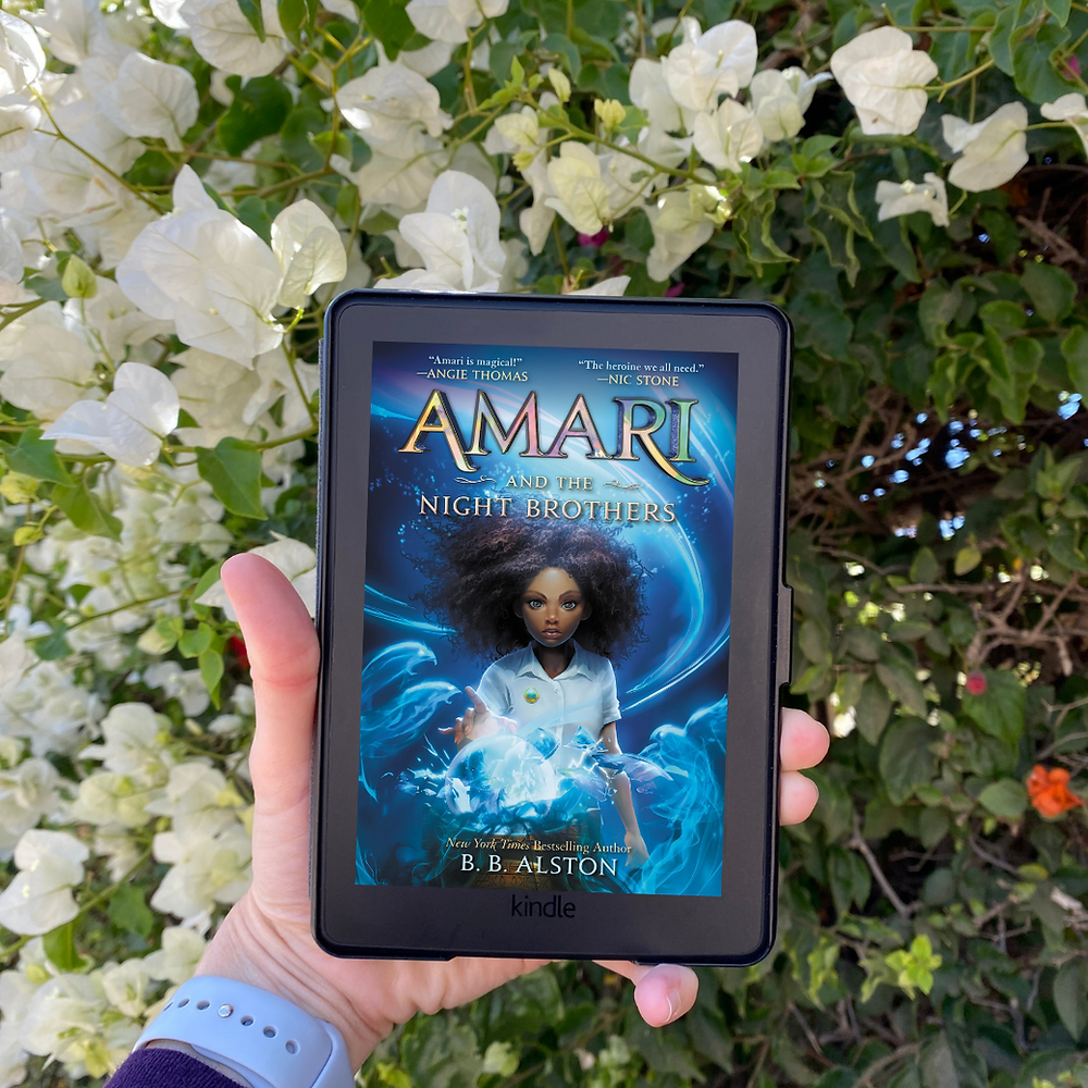 Book Cover of Amari and the Night Brothers by B. B. Alston above white flowers