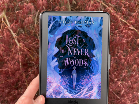 Aiden Thomas's LOST IN THE NEVER WOODS - A Dark and Twisty Peter Pan Retelling
