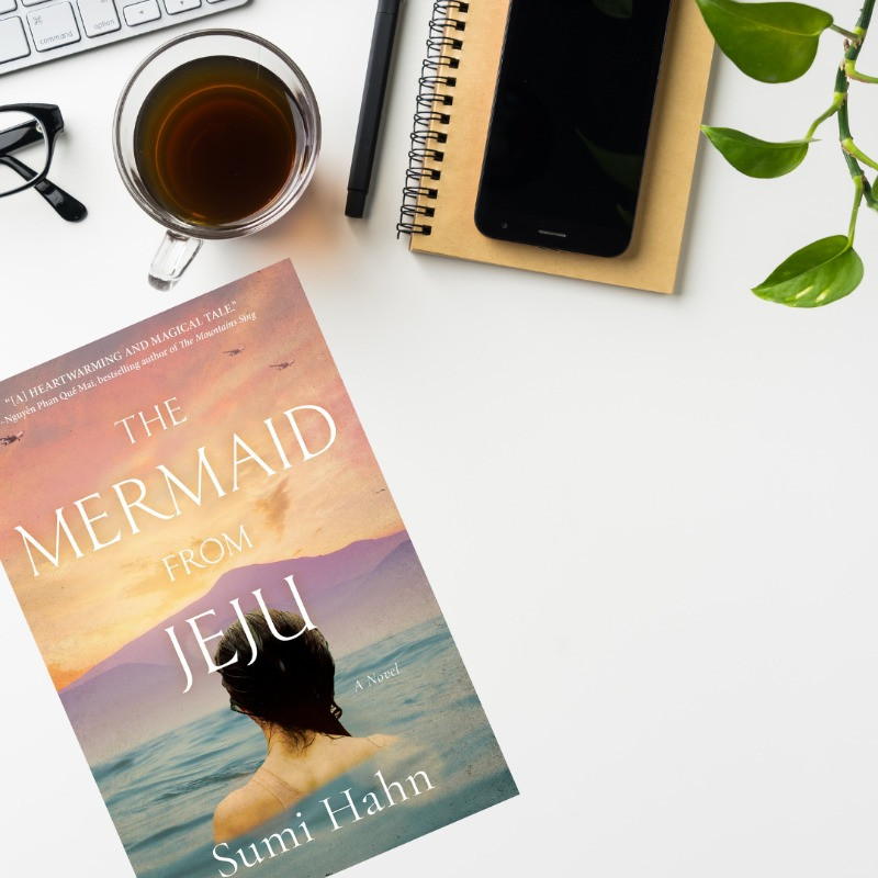 Desk picture with Book Cover of The Mermaid of Jeju by Sumi Hahn