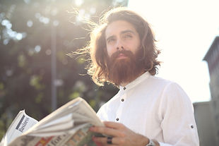 man-in-white-long-sleeves-reading-a-news