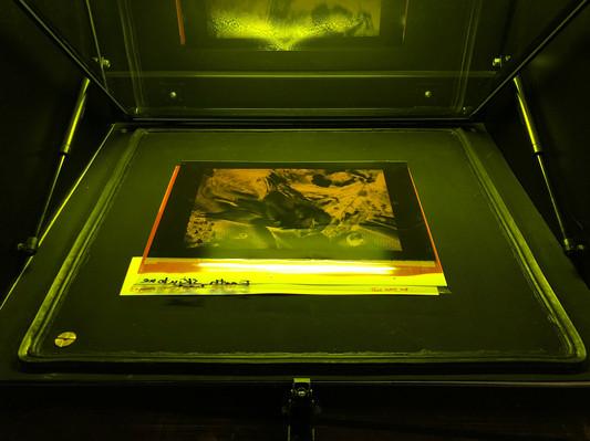 Light exposure unit with vaccum table.