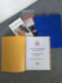 Parent's folder, book, birth flags and massage oil