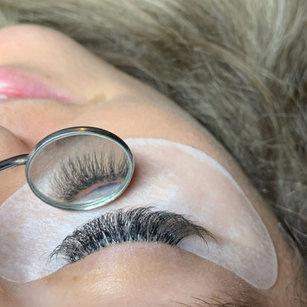 Eyelashes through reflective mirror.