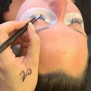 Beauty therapist working on eyelashes