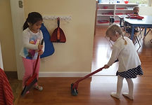 Sweeping and mopping at CK Montessori.jpg