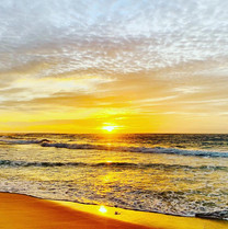 Sunrise Glow over Nobbys Beach