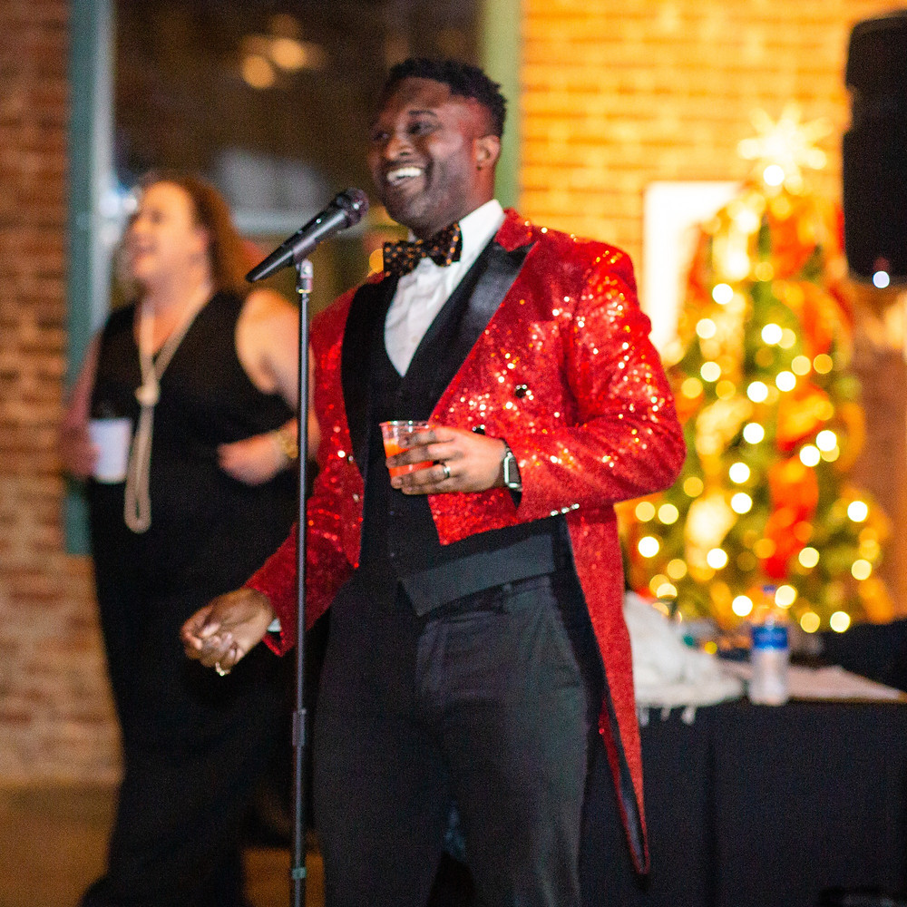 Guillermo Jemmott singing and stunting in an Alexandria Bagwell design