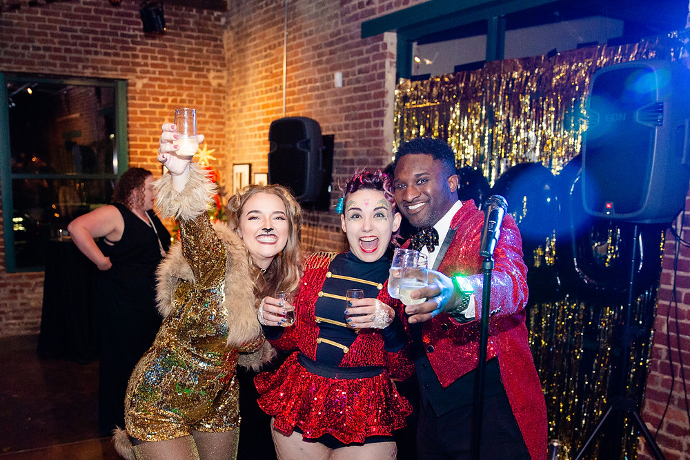 Alexandria Bagwell and Samantha and Guillermo Jemmott lead the New Year's toast!