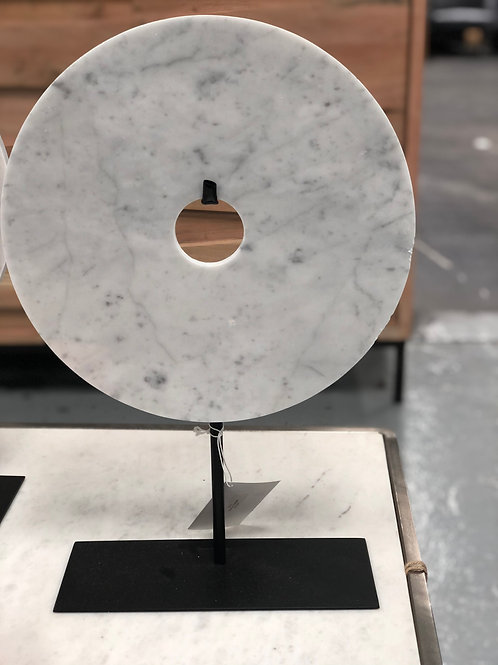 Light gray marble disc on stand