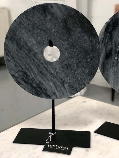 dark gray marble disc on base