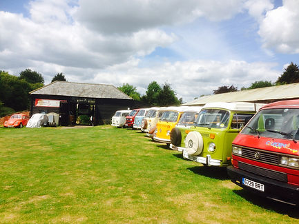 The VW Bullibarn Paddock with row of Campervans for sale