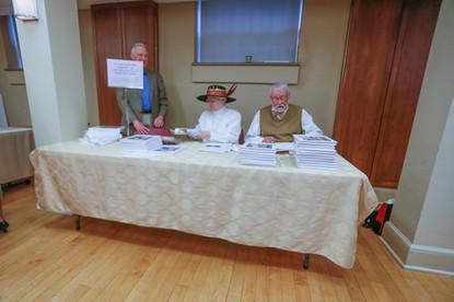 John Wagner, Linda Parker, and Dave Richardson sell books