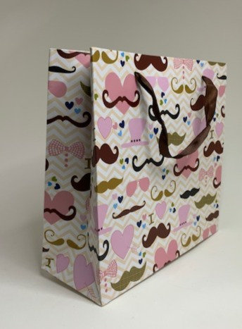 Pink designed paper bag (8 inch height approx)