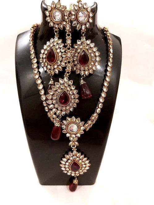 Heavy kundan set with heavy tika & heavy earring