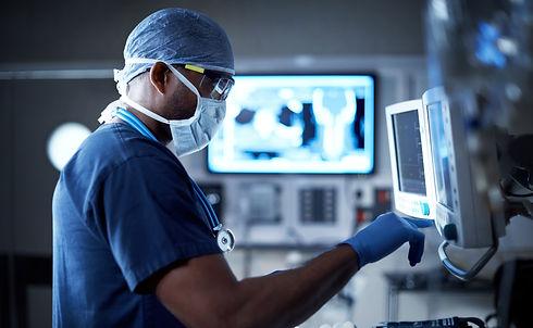 monitoring his patient's vitals.jpg