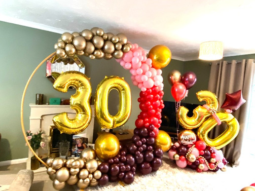 Organic hoop arch and balloon marquee